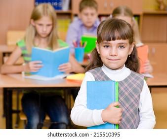 portrait of pretty schoolgirl with books