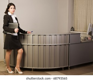 Portrait of the pretty secretary in a office