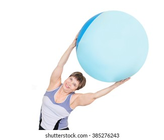 Portrait of pretty senior woman exercising with gymnastic ball on a white background