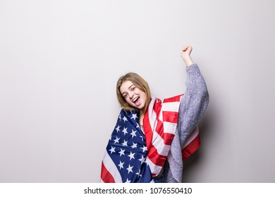 portrait of pretty teen girl holding USA flag