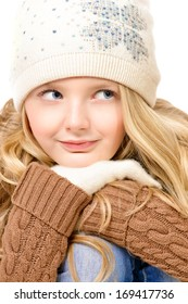 Portrait of a pretty ten years girl in warm clothes smiling at camera. Isolated over white.