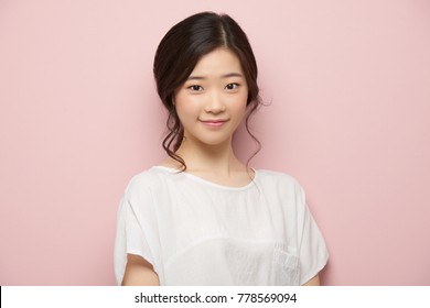 Portrait of pretty Vietnamese young woman smiling and looking at camera
