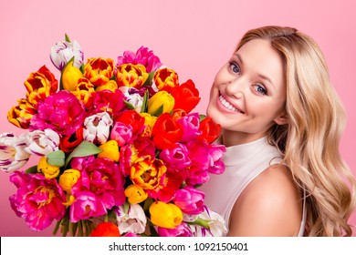 Portrait of pretty wife charming lovely mother gorgeous girlfriend having big bouquet of colorful aromatic tulips looking at camera isolated on pink background
