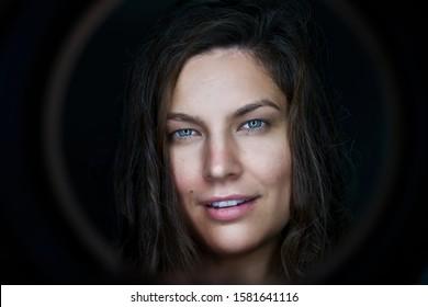 Portrait of pretty woman dark hair, blue eyes. Face. Smile. Smiling. happy