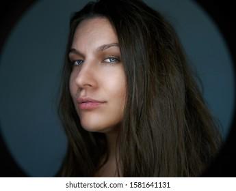Portrait of pretty woman dark hair, blue eyes pretty lady female model