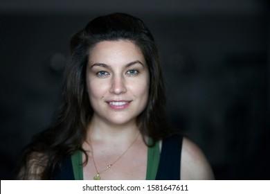 Portrait of pretty woman dark hair, blue eyes