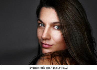 Portrait of pretty woman dark hair, blue eyes. Natural smile.  smiling  beautiful