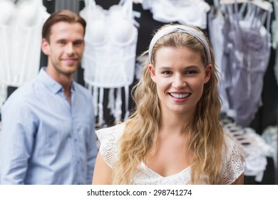 Portrait of a pretty woman with her boyfriend in the background