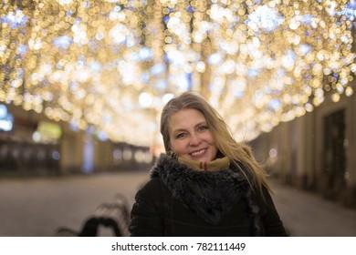 Portrait of pretty woman in the night city