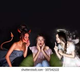 Portrait of pretty woman sitting at home. Angel and devil talking to her from different sides of picture. She is hesitating about decision