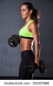 Portrait of a pretty young adult sporty attractive sexy and sensuality beautiful brunette woman at the gym