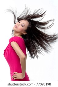 Portrait of a pretty young asian girl with hair lightly fluttering in the wind