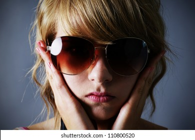 84e8a059099 Portrait of a pretty young blond teenager girl with large dark sunglasses