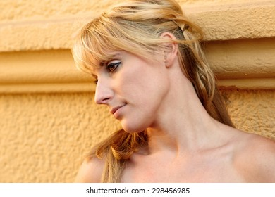 Portrait of a pretty young blond woman in moody light