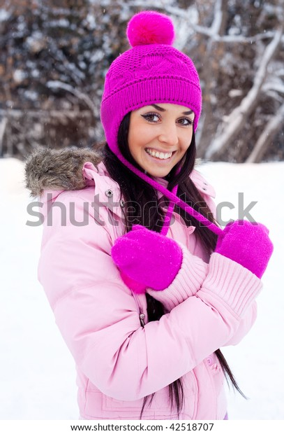 portrait of a pretty young brunette girl outdoor on a warm winter day