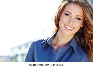 Portrait of pretty young business woman smiling
