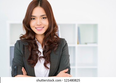 Portrait of a pretty young female employee