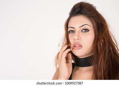 Portrait of pretty young female on white background