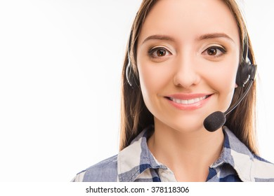 A portrait of pretty young female worker in call centre