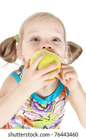 Portrait of pretty young girl with green apple over white