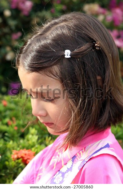 Portrait of a pretty young girl outdoors.