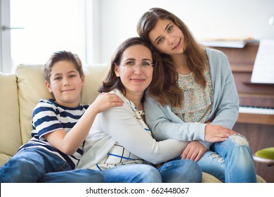 Portrait of pretty young mother with her two children adorable teenager daughter and son