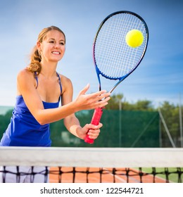 Portrait of a pretty young tennis player