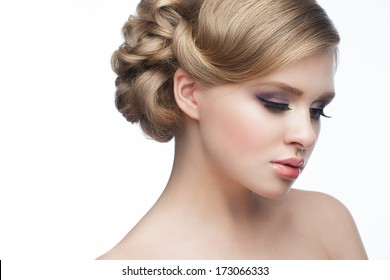 Portrait of a pretty young woman with beautiful hairstyle and makeup