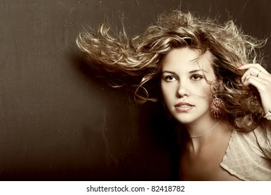 Portrait of pretty young woman with curly hair