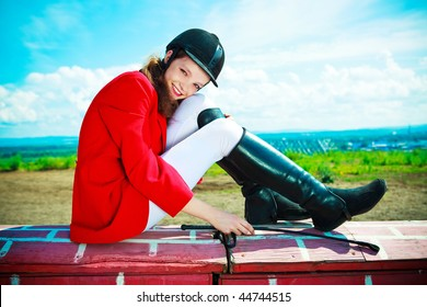 portrait of a pretty young woman dressed as an equestrian