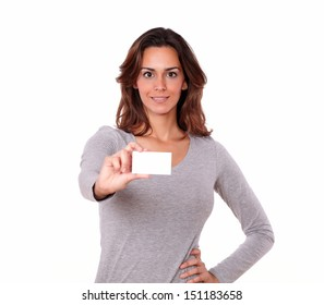 Portrait of a pretty young woman holding blank business card of copyspace on white background