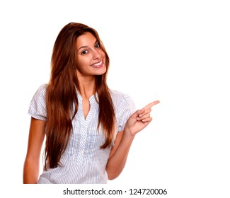 9287a48422d Portrait of a pretty young woman with long brown hair pointing to her left  while is