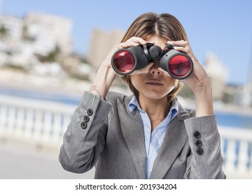 portrait of a pretty young woman looking through the binoculars