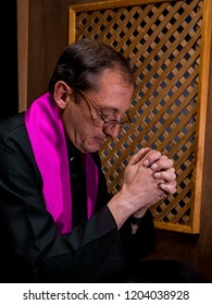 Portrait of a priest in his confessional
