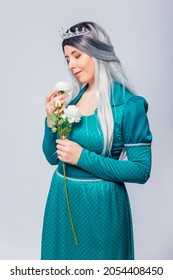 Portrait of a princess in a medieval, fantasy, turquoise dress with ash hair and a silver crown, posing with white roses in hands, isolated on a white background.