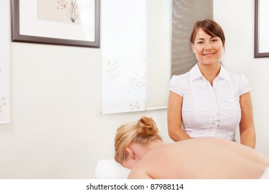 Portrait of a professional acupuncturist posing with patient ready for treatment