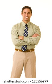 Portrait of a professional business person wearing a shirt and tie standing with arms folded isolated on white background