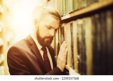 Portrait of professional businessman in library.
