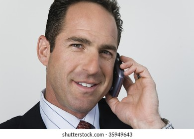 Portrait of professional businessman speaking on mobile phone.