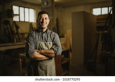 portrait of a professional carpenter in his workshop
