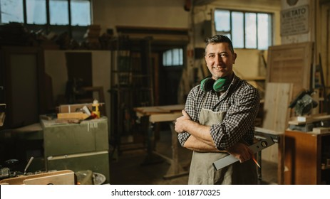 portrait of a professional carpenter in his workshop