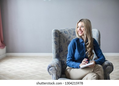 Portrait of professional counselor being ready to take notes. Beautiful young psychotherapist.