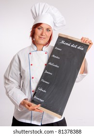 Portrait of a professional female chef holding a menu slate