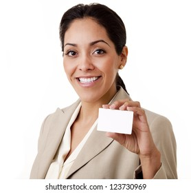 Portrait of a professional Hispanic business woman wearing a tan suit holding a business card looking at camera isolated on white