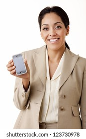 Portrait of a professional Hispanic business woman wearing a tan suit holding a mobile phone looking at camera isolated on white