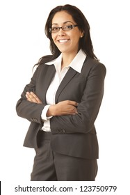 Portrait of a professional Hispanic business woman wearing a tan suit looking at camera isolated on white