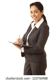 Portrait of a professional Hispanic business woman wearing a grey suit writing on a clipboard looking at camera isolated on white