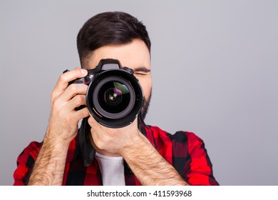 Portrait of  professional photographer with digital camera taking photos