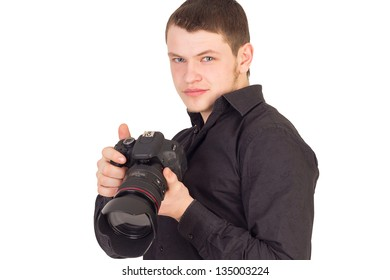 Portrait of professional photographer holding camera and smiling isolated on white background