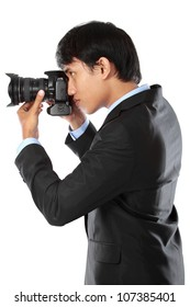 portrait of professional photographer ready to take photo using dslr camera